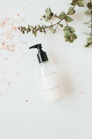 Healthcare spa concept with copy space liquid soap bottle on white background. Flat lay, top view beauty lifestyle composition.