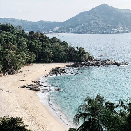 Beautiful view at empty exotic beach with jungle, rocks and  blue sea. Travel, summer and vacation concept. 스톡 콘텐츠