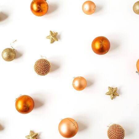 Christmas / New Year composition. Colorful Christmas baubles / balls and stars pattern on white background. Flat lay, top view festive holiday concept.