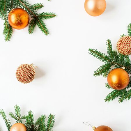 Christmas  New Year holiday composition. Frame of Christmas baubles  balls and fir branches on white background. Flat lay, top view festive concept.