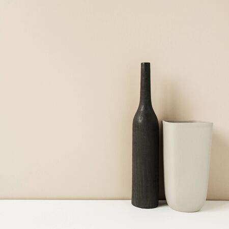 Two stylish vases on pastel neutral background. Modern interior decoration design concept.