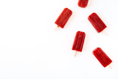 Red ice-creams on white background. Flat lay, top view. Zdjęcie Seryjne