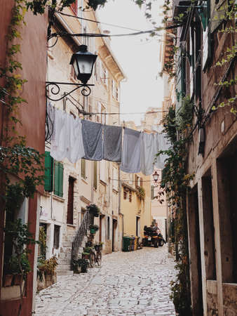 2019, Europe, Croatia, Rovinj. Architecture of old town of Rovinj with clotheslines across the street. Travel, adventure concept. Touristic place.