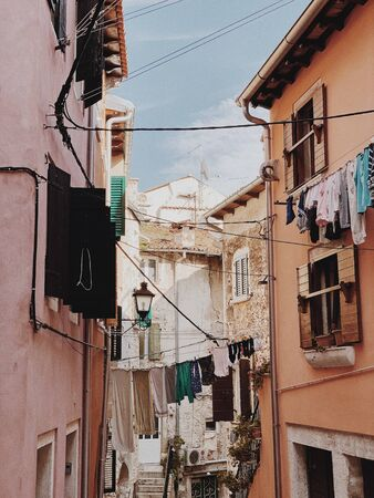 2019, Europe, Croatia, Rovinj. Architecture of old town of Rovinj with clotheslines across the street. Travel, adventure concept. Old city background.