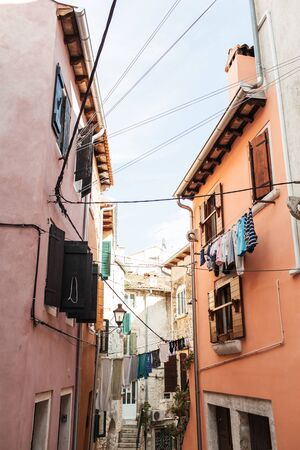 2019, Europe, Croatia, Rovinj. Architecture of old town of Rovinj with clotheslines across the street. Travel, adventure concept. City background.