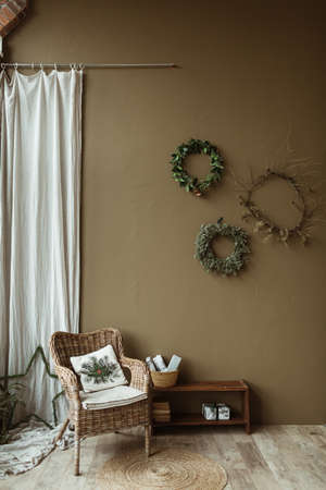 Round homemade wreath frames made of fir needles and branches on olive wall. Christmas celebration decoration. New Year composition. Modern interior design. Zdjęcie Seryjne