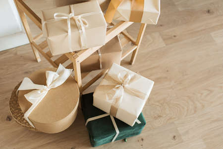 Homemade craft gift boxes with bow ties. Merry Christmas / Happy New Year holidays celebration concept. Zdjęcie Seryjne