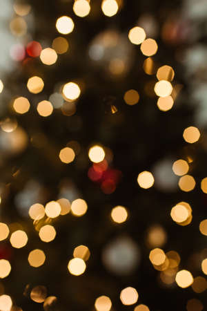 Blurred light on Christmas tree. Bright glow bokeh.