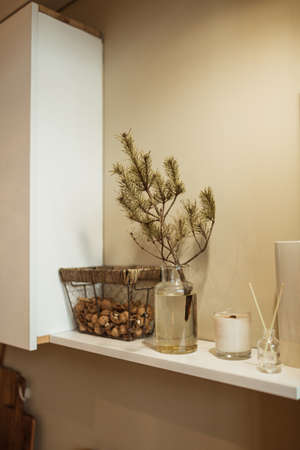 Kitchen interior design decorated with fir branch in vase. Christmas / New Year celebration decorations. Zdjęcie Seryjne