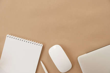 Minimal home office desk workspace on pastel beige background. Blank sheet notebook, laptop. Business template with copy space for blog, website, social media. Girl / Lady boss work concept. Imagens