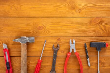 Top view layout of tools for repair on wooden background, free space for text