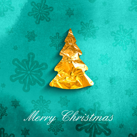 vector illustration of a Xmas poster with golden foil Christmas tree symbol on turquoise watercolor background with snowflakes. Holiday postcard templates for web or printed media design. Merry Christmas and Happy New Year Vector