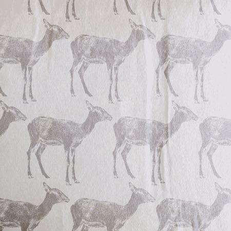 gazelle: vector vintage illustration of an antelope or a goat pattern on the old wrinkled paper background