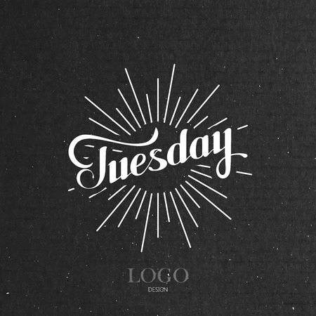 light rays: vector typographical illustration with ornate word Tuesday and light rays on the black cardboard texture