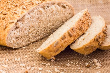 sesame cracker: Slices of rye bread on sackcloth