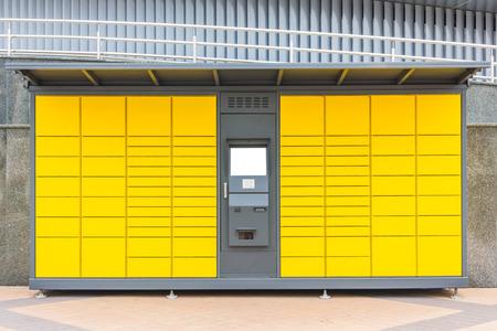 correspond: Self-service terminal in yellow facade