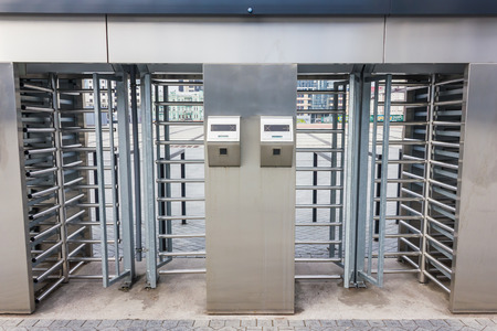 turnstile: Big metal turnstile outdoors close up Stock Photo