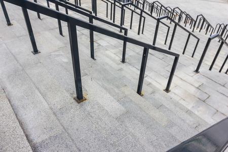 Stone steps with black metal railing photo