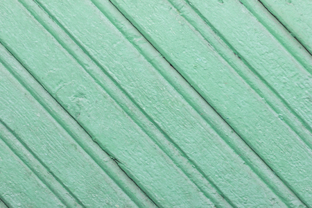 Green background of wooden planks. Diagonal lines. Pattern. Geometric
