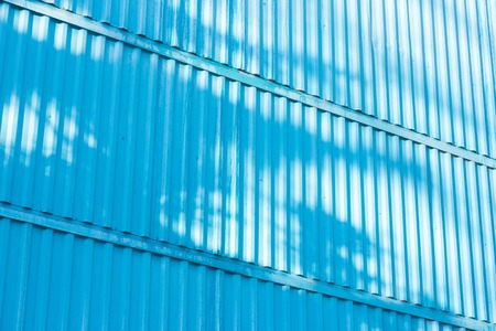 The blue figure of corrugated texture. Concept: reliable, abstract, creative, art, fence. Standard-Bild