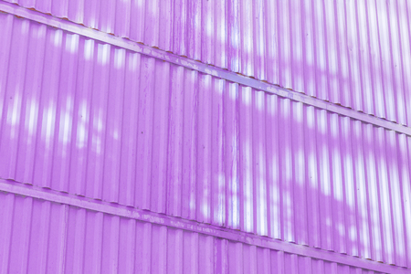 The magenta color of figure of corrugated texture. Concept: reliable, abstract, creative, art, fence. Standard-Bild