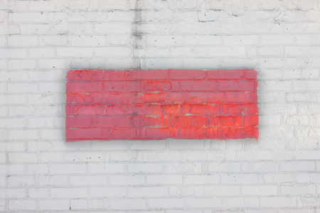 White brick wall with a red rectangle in the center. Art background. Fence. The wall.