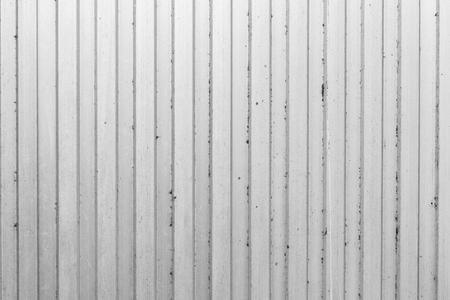 The grey color of figure of corrugated texture. Concept: reliable, abstract, creative, art, fence.
