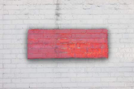 White brick wall with a red rectangle with shadow in the center. Art background. Fence. The wall. Standard-Bild