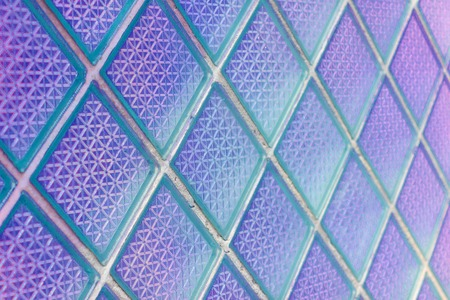 Decorative and glossy glass block window as a texture or for background. The wall. Geometric background.