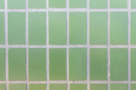 Facade of green mat ceramic tile texture. Geometric figures. Rectangles. Standard-Bild