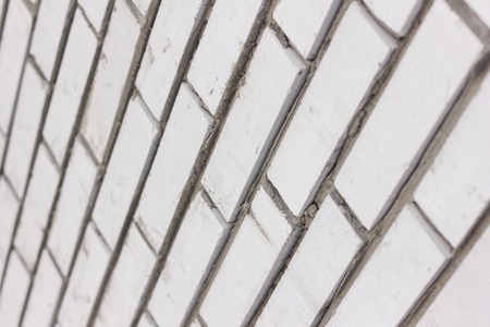 White wall of brick close-up angle. Pattern as a background. Diagonal.