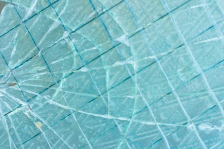 Broken decorative and glossy glass block window as a texture or for background. The wall. Geometric background.