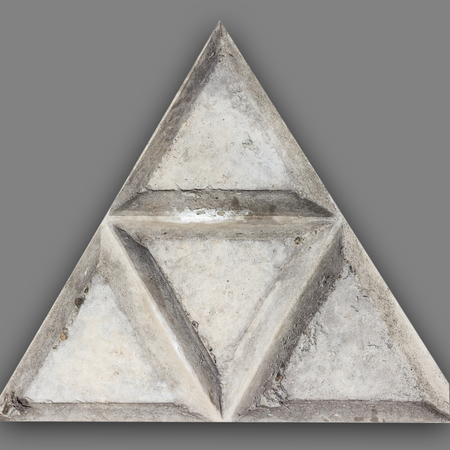 A fragment of concrete fence. Tracery pattern of stone wall as triangle. Isolate. Clipping path included.