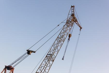 Tower crane on a construction site at sunrise Standard-Bild