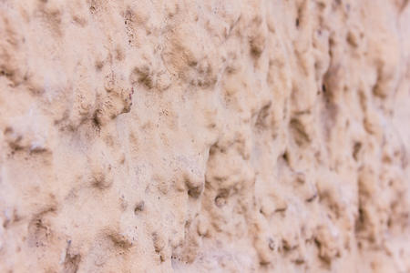 Brown decorative plaster on the wall. Art background