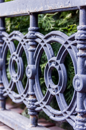 Elements of black metallic forged fence with spikes. Standard-Bild