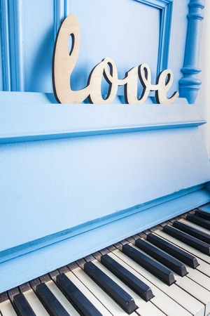 Blue piano close-up with black and white keys Standard-Bild