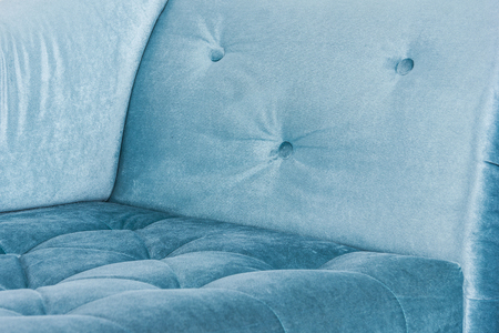 Blue sofa in white interior and gray floor. Venetian style Standard-Bild
