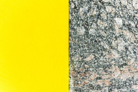Two-color abstract background. Part yellow and part marble. Texture of natural marble background. Pattern