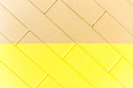 Yellow and brown brick wall texture. Two-color abstract background