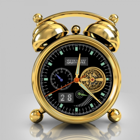 Exclusive mechanical alarm clock with a tourbillon, a gold case on a gray background with reflection photo