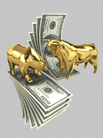 The image of the bull and the bear made of gold, against the background of dollar banknotes on a gray background photo