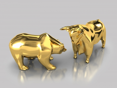 The image of the bull and the bear made of gold on a gray background with reflection photo
