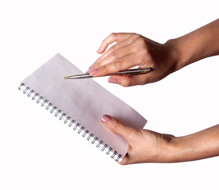 woman on phone: Woman hand with pen and notebook Stock Photo
