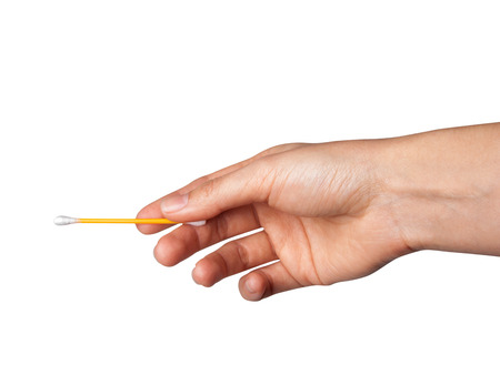 Dna test. Cotton swab. Close up of womans hand holding a cotton bud.