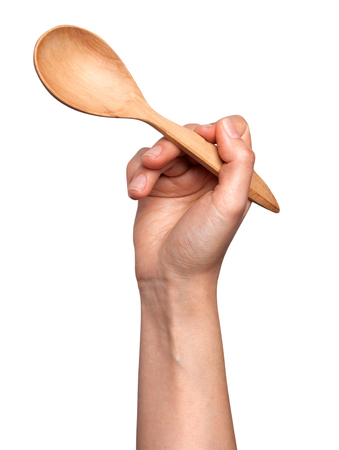 Womans Hand hold the spoon on white.