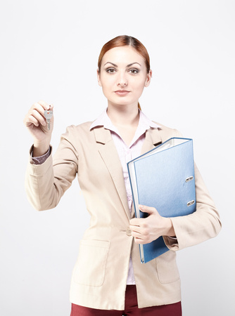 Young business woman with a blue folder and keys. Business, real estate.