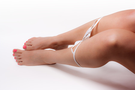 Female legs with panties deflated isolated on white. Stock Photo