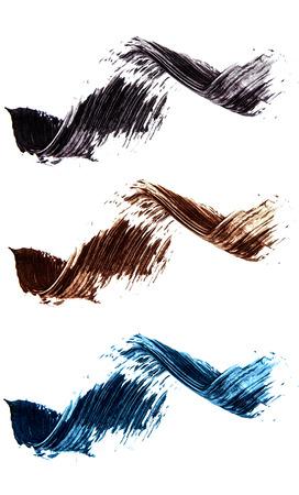 Set of flat mascara swatches. Brush strokes of different shades of mascara. Colorful swirls isolated on white background. Stock Photo