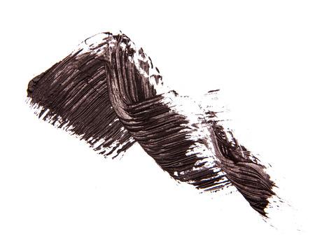 Borstelstrook van zwarte schaduw van mascara op wit Stockfoto